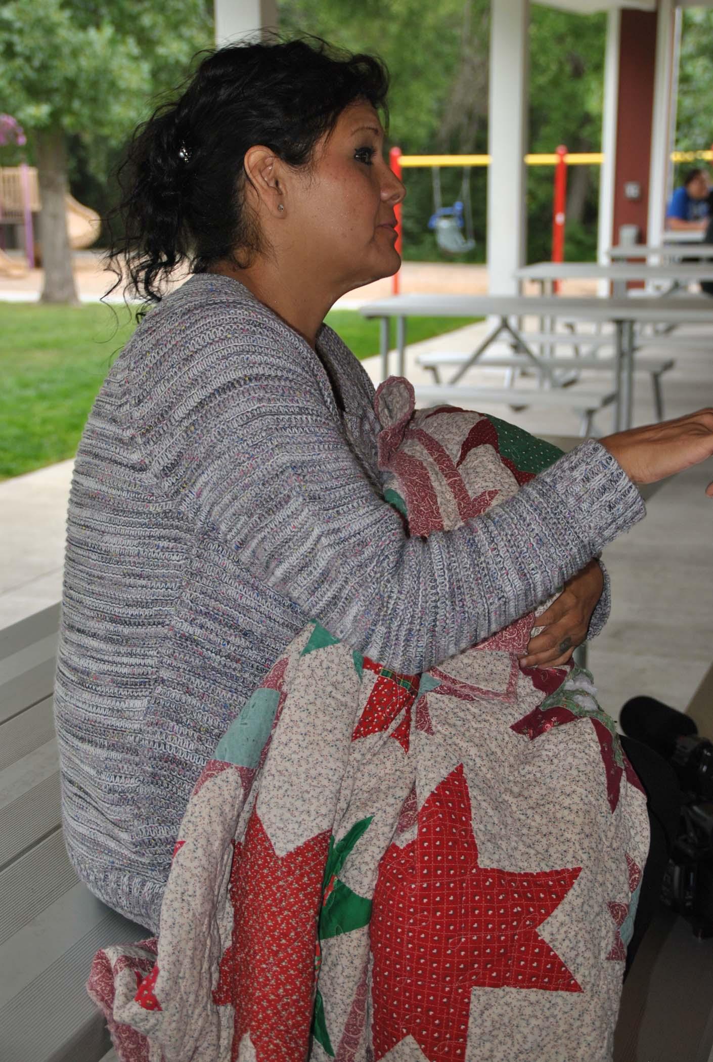 Tarita Silk, Savanna Greywind's aunt, talks to volunteers - photo by C.S. Hagen