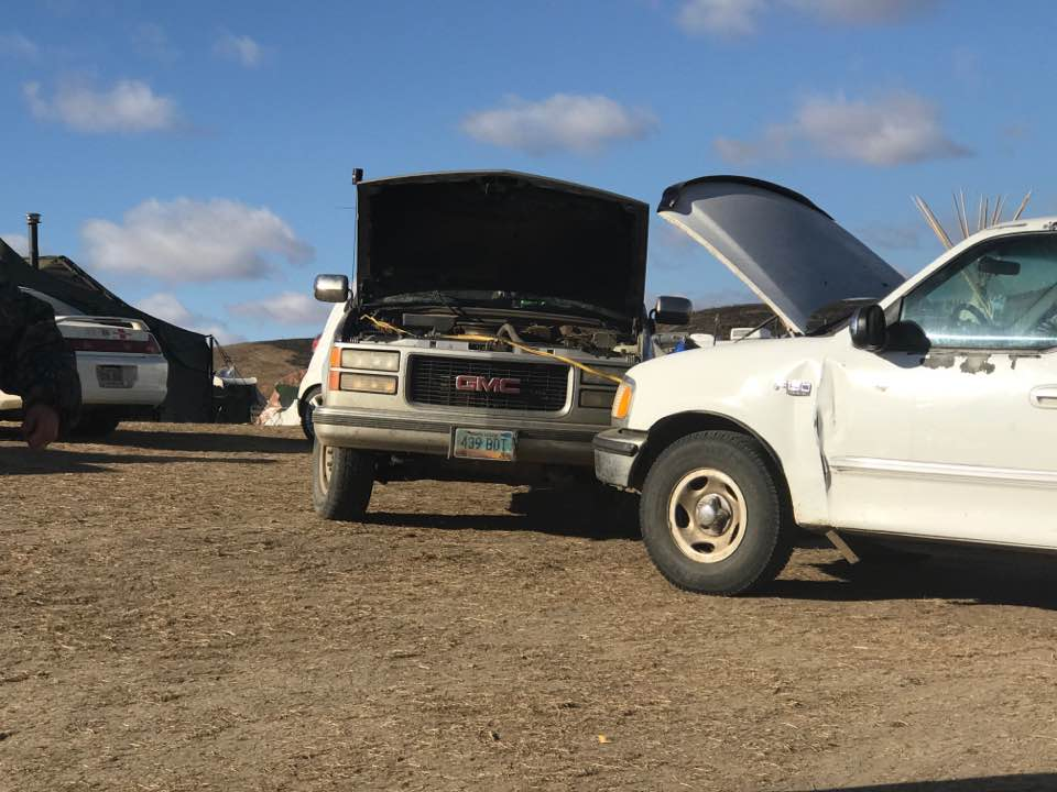 Two automobiles that suddenly lost battery power at Standing Rock camps - photo provided by Myron Dewey